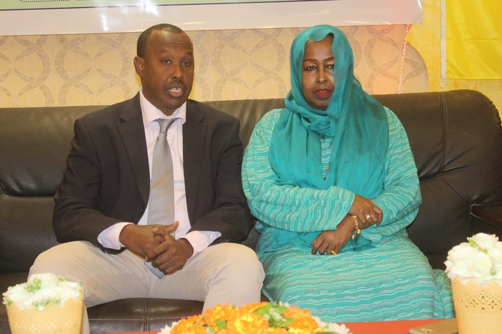 Somalia's minister for youth and sports, Honorable Khadija Mohamed Diriye RIGHT sits with Somali Football Federation president Abdiqani Said Arab