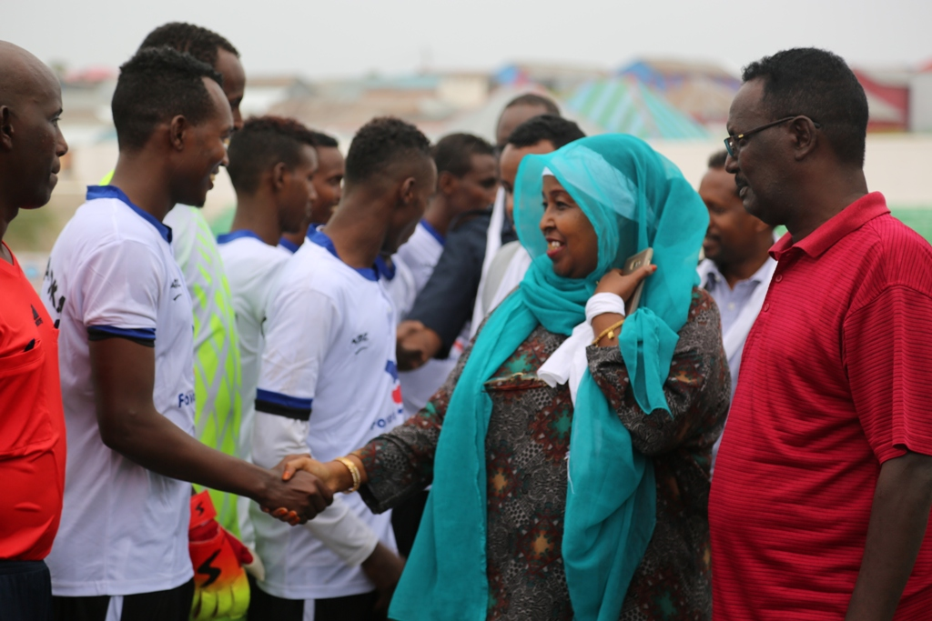 Minister for youth and Sports Khadija Mohamed Diriye Wears a white piece of cloth wrapped around her wrist while shaking hands with the team players before the match kick off on Thursday Sep 21 2017