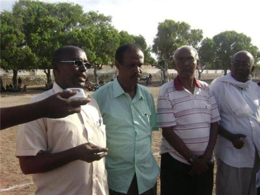 Late Hussein Ali Abdulle 2nd from Right looks on as former Somali FA President Ali Said Guled Roble LEF gives an interview on May 9 2010